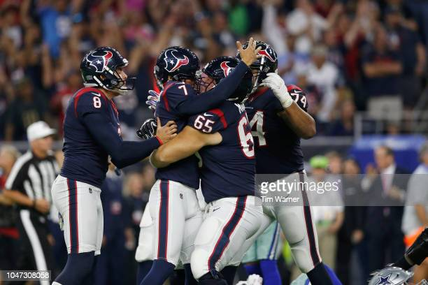 Greg Mancz of the Houston Texans celebrates with Ka'imi Fairbairn after the gamewinning field goal against the Dallas Cowboys in overtime at NRG...