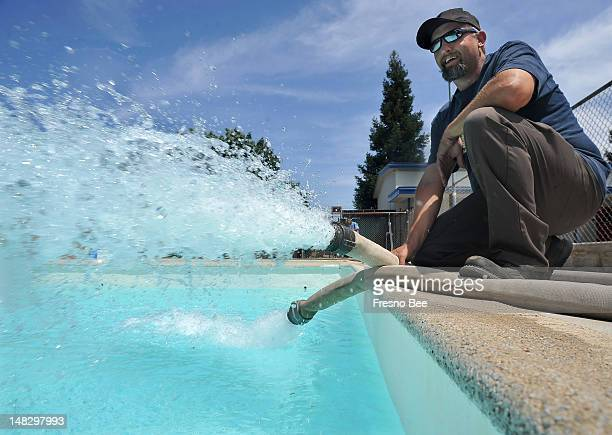 Greg Mastrantuono of the city's Park and Recreation department fills the Pinedale Community Center pool from a fire hydrant on Friday July 13 after...