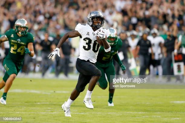 Greg McCrae of Central Florida runs the ball into the end zone for the score during the College Football game between the UCF Knights and the South...