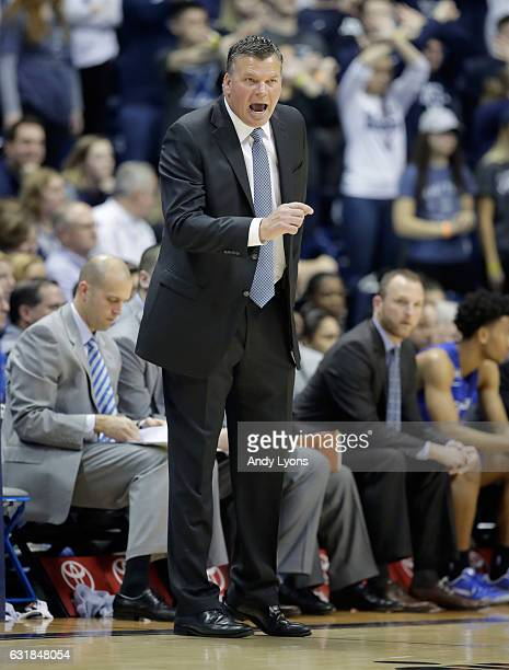 Greg McDermott the head coach of the Creighton Blue Jays gives instructions to his team against the Xavier Musketeers during the game at Cintas...