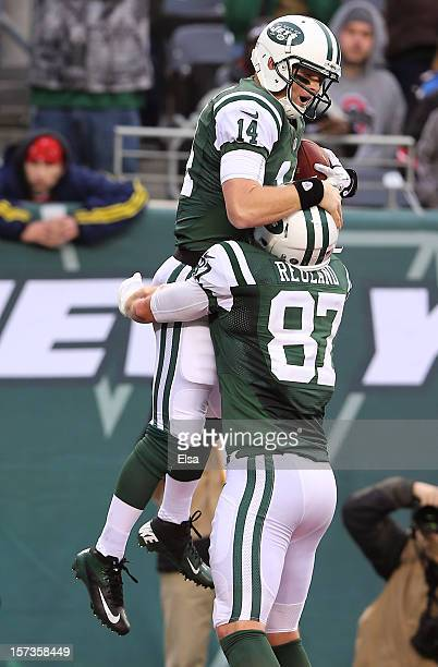 Greg McElroy of the New York Jets celebrates the touchdown with teammate Konrad Reuland in the fourth quarter against the Arizona Cardinals on...