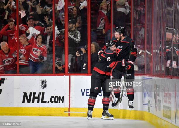 Greg McKegg celebrates with Jordan Martinook of the Carolina Hurricanes after scoring against the New York Islanders in the second period of Game...