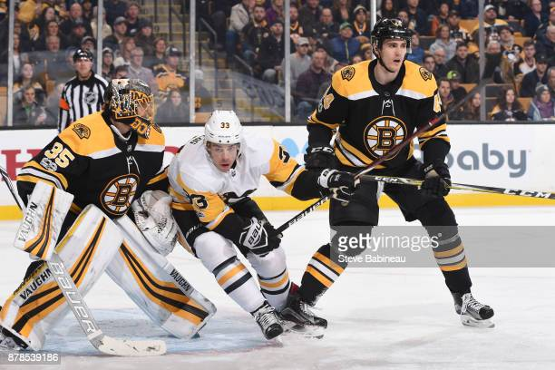 Greg McKegg of the Pittsburgh Penguins against Anton Khudobin and Rob O'Gara of the Boston Bruins at the TD Garden on November 24 2017 in Boston...