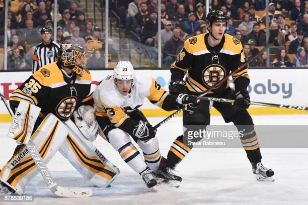 Greg McKegg of the Pittsburgh Penguins against Anton Khudobin and Rob O'Gara of the Boston Bruins at the TD Garden on November 24, 2017 in Boston,...
