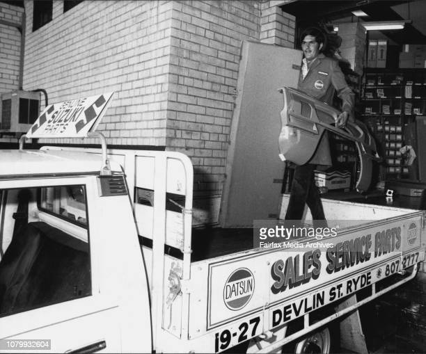 Greg McNee driver loading spares on to truck at Davidson Motors March 08 1983