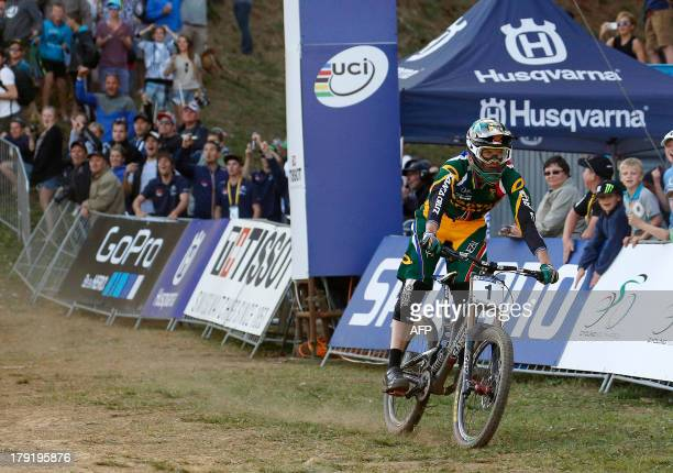 Greg Minnaar of South Africa crosses the finish line to win the downhill finals during the cross-country world championships at the CASCADES Mountain...