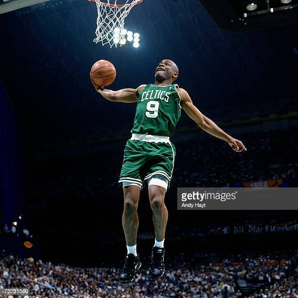 Greg Minor of the Boston Celtics attempts a dunk during the 1996 Slam Dunk Contest on February 10 1996 at the Alamodome in San Antonio Texas NOTE TO...