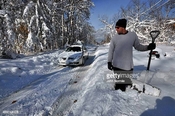 Greg Mitri shovels his way through nearly five feet of snow on November 19 2014 in the Lakeview neighborhood of Buffalo New York The record setting...