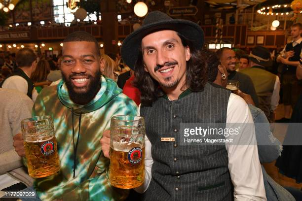 Greg Monroe and Nihad Djedovic attend the FC Bayern Basketball Wiesn at the Paulaner Festzelt during the Oktoberfest at Theresienwiese on September...