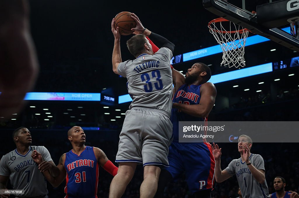 Greg Monroe of Detroit Pistons in action against Mirza Teletovic (33) of Brooklyn Nets on December 21, 2014 at the Barclays Center in Brooklyn, NY.