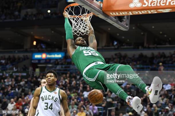 Greg Monroe of the Boston Celtics dunks against the Milwaukee Bucks during the first half of a game at the Bradley Center on April 3 2018 in...