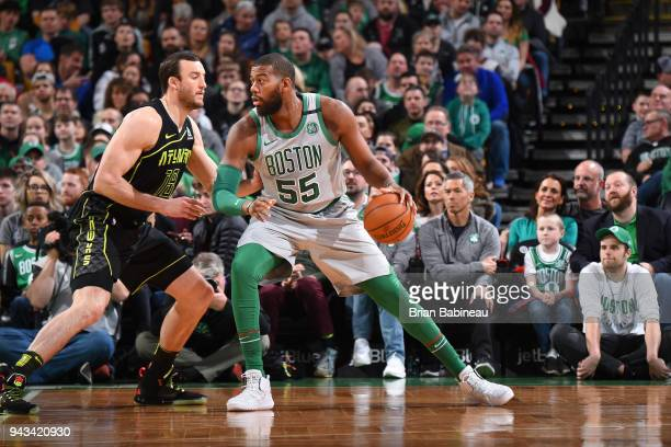 Greg Monroe of the Boston Celtics handles the ball against Miles Plumlee of the Atlanta Hawks on April 8 2018 at the TD Garden in Boston...