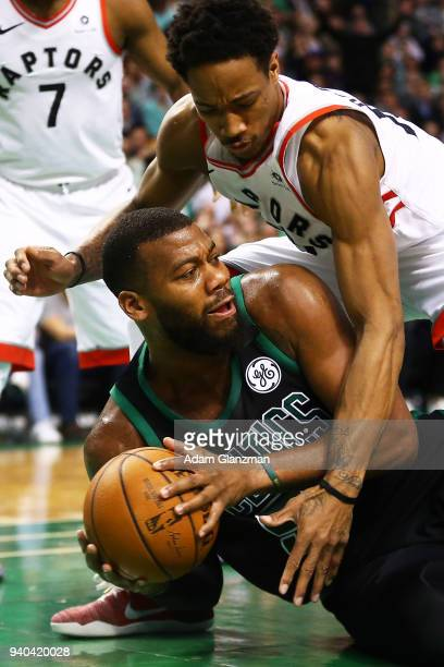 Greg Monroe of the Boston Celtics is fouled by DeMar DeRozan of the Toronto Raptors during a game at TD Garden on March 31 2018 in Boston...