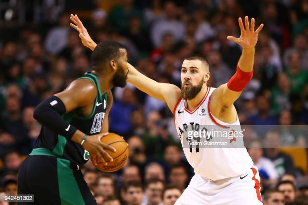 Greg Monroe of the Boston Celtics is guarded by Jonas Valanciunas of the Toronto Raptors during a game at TD Garden on March 31 2018 in Boston...