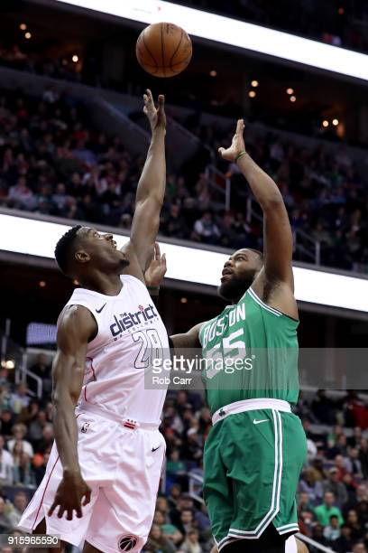 Greg Monroe of the Boston Celtics puts up a shot over Ian Mahinmi of the Washington Wizards at Capital One Arena on February 8 2018 in Washington DC...