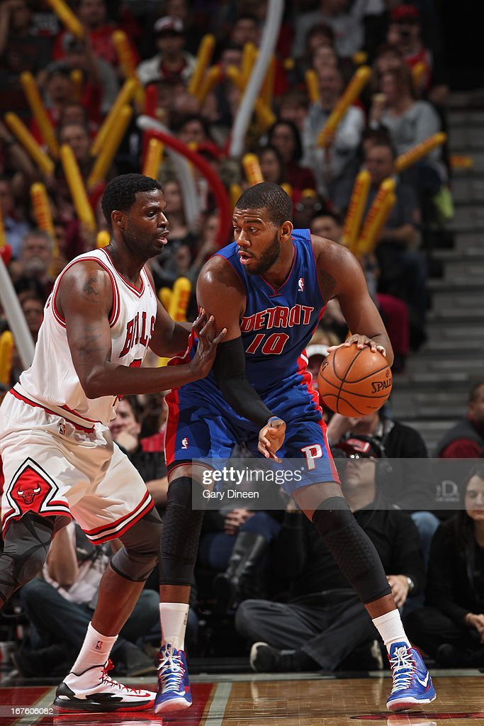 Greg Monroe #10 of the Detroit Pistons controls the ball against Nazr Mohammed #48 of the Chicago Bulls on March 31, 2013 at the United Center in Chicago, Illinois.