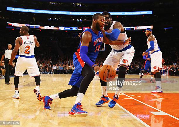 Greg Monroe of the Detroit Pistons dribbles against Amar'e Stoudemire of the New York Knicks during their game at Madison Square Garden on January 7...