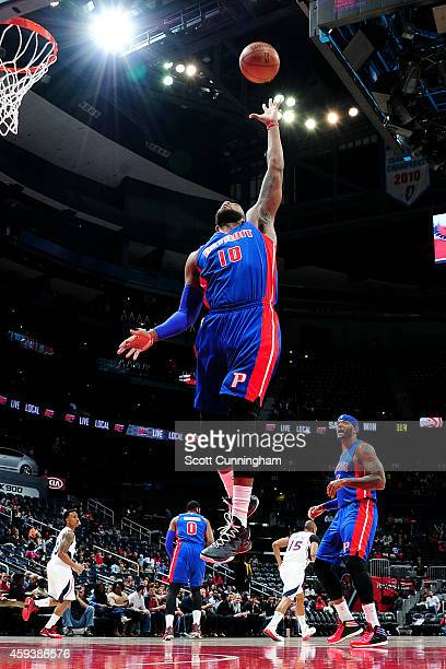 Greg Monroe of the Detroit Pistons grabs a rebound against the Atlanta Hawks on November 21 2014 at Philips Arena in Atlanta Georgia NOTE TO USER...