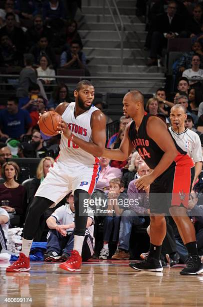 Greg Monroe of the Detroit Pistons handles the ball against Chuck Hayes of the Toronto Raptors on December 19 2014 at the Palace of Auburn Hills in...