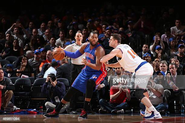 Greg Monroe of the Detroit Pistons handles the ball against Jason Smith of the New York Knicks on April 15 2015 at Madison Square Garden in New York...