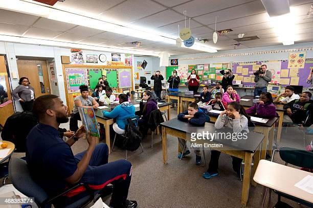 Greg Monroe of the Detroit Pistons reads to students to promote the importance of literacy and education on March 30 2015 at Herrington Elementary...