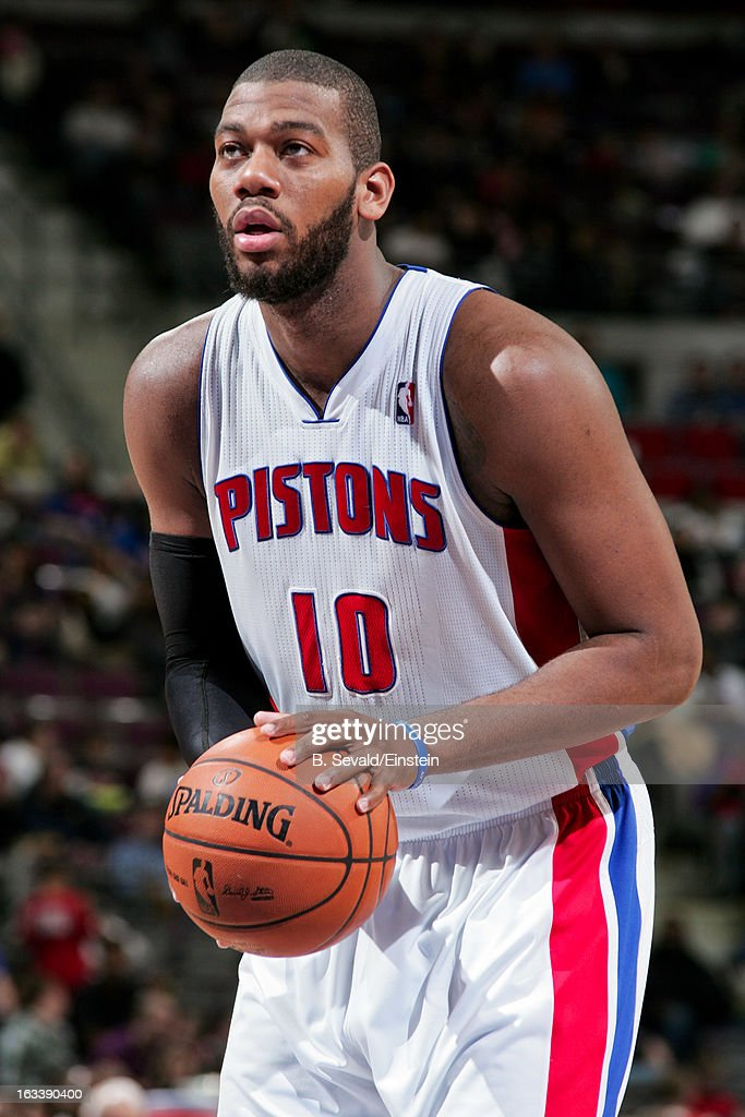 Greg Monroe #10 of the Detroit Pistons shoots a free-throw against the Dallas Mavericks on March 8, 2013 at The Palace of Auburn Hills in Auburn Hills, Michigan.
