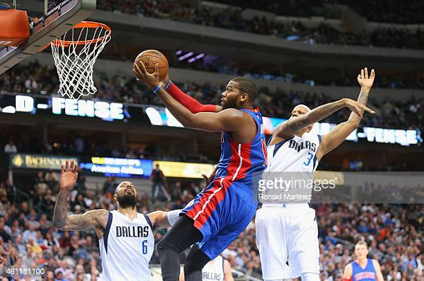 Greg Monroe of the Detroit Pistons takes a shot against Charlie Villanueva of the Dallas Mavericks at American Airlines Center on January 7 2015 in...