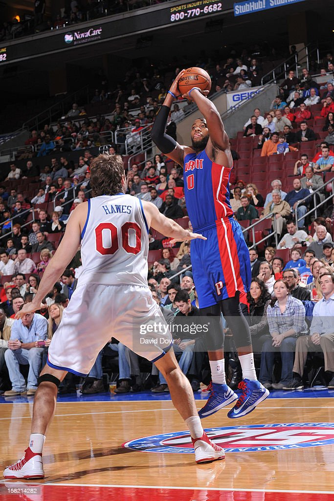 Greg Monroe #10 of the Detroit Pistons takes a shot over Spencer Hawes #00 of the Philadelphia 76ers during the game at the Wells Fargo Center on December 10, 2012 in Philadelphia, Pennsylvania.
