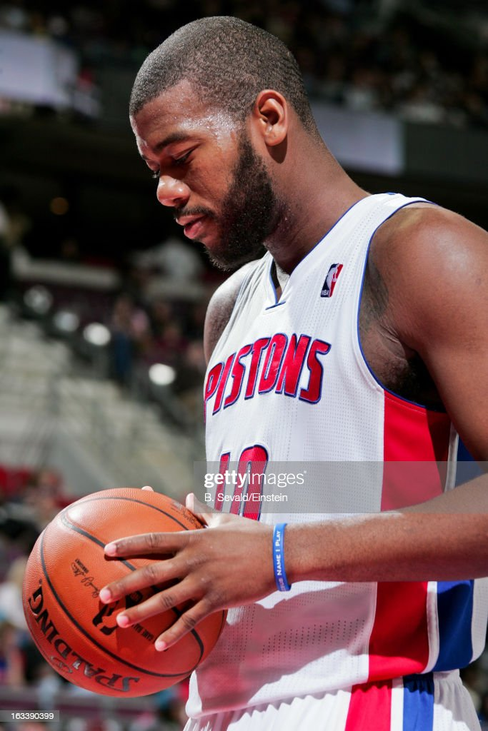 Greg Monroe #10 of the Detroit Pistons waits to resume play action against the Dallas Mavericks on March 8, 2013 at The Palace of Auburn Hills in Auburn Hills, Michigan.