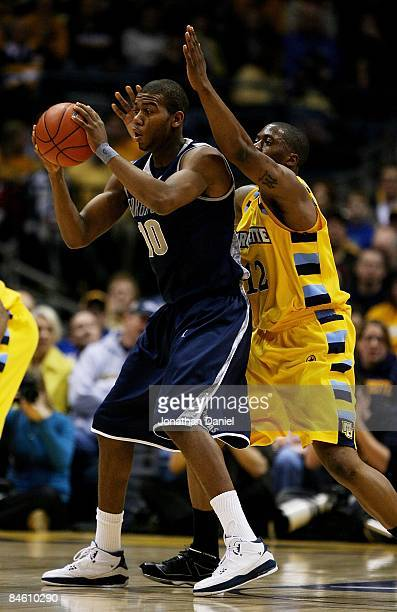Greg Monroe of the Georgetown Hoyas looks to pass as Dwight Burke of the Marquette Golden Eagles defends on January 31, 2009 at the Bradley Center in...