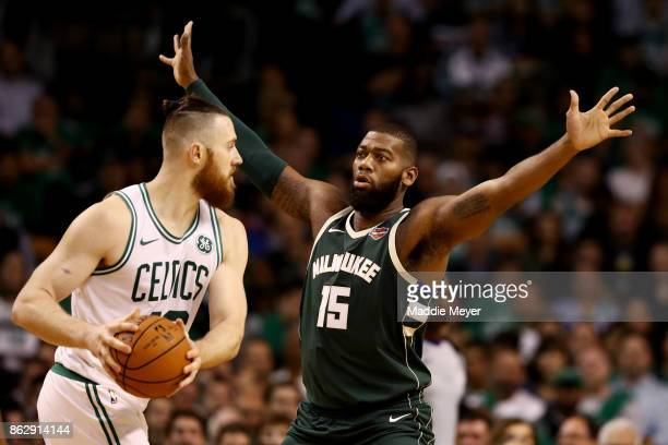 Greg Monroe of the Milwaukee Bucks defends Aron Baynes of the Boston Celtics during the second quarter at TD Garden on October 18 2017 in Boston...