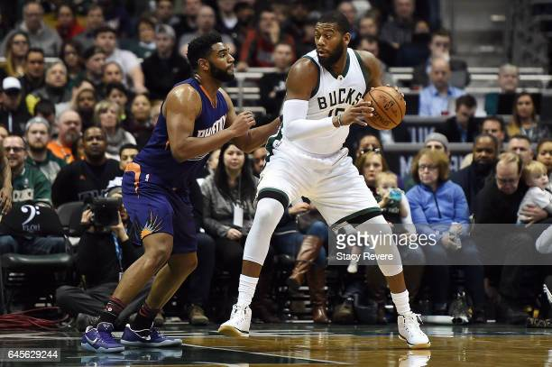 Greg Monroe of the Milwaukee Bucks is defended by Alan Williams of the Phoenix Suns during the first half of a game at the BMO Harris Bradley Center...
