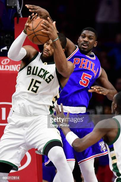 Greg Monroe of the Milwaukee Bucks is pressured from behind by Alex Poythress of the Philadelphia 76ers during the third quarter at the Wells Fargo...