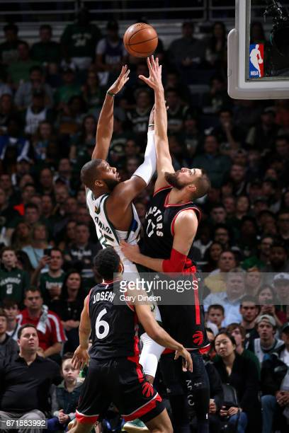 Greg Monroe of the Milwaukee Bucks shoots the ball during the game against Jonas Valanciunas of the Toronto Raptors in Game Four during the Eastern...