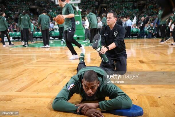 Greg Monroe of the Milwaukee Bucks stretches before the game against the Boston Celtics on October 18 2017 at the TD Garden in Boston Massachusetts...