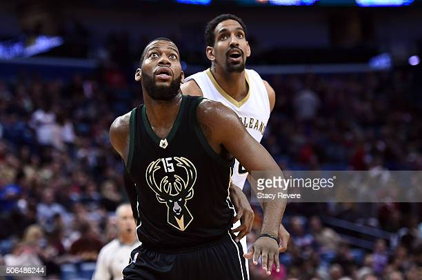 Greg Monroe of the Milwaukee Bucks works against Alexis Ajinca of the New Orleans Pelicans during the first half of a game at the Smoothie King...