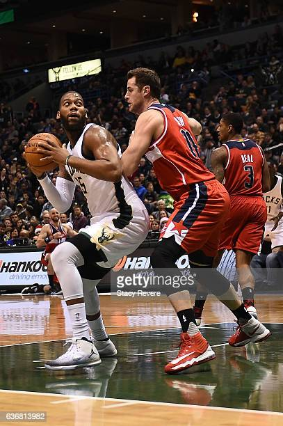 Greg Monroe of the Milwaukee Bucks works against Jason Smith of the Washington Wizards during a game at the BMO Harris Bradley Center on December 23...