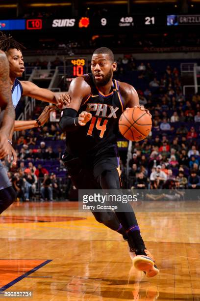 Greg Monroe of the Phoenix Suns handles the ball against the Memphis Grizzlies on December 21 2017 at Talking Stick Resort Arena in Phoenix Arizona...