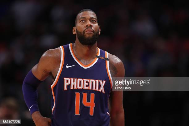Greg Monroe of the Phoenix Suns looks to the sidelines during the third quarter of the game against the Detroit Pistons at Little Caesars Arena on...