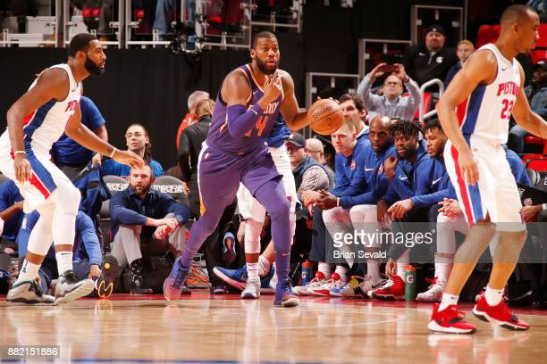 Greg Monroe of the Phoenix Suns moves the ball down court as they play against the Detroit Pistons on November 29 2017 at Little Caesars Arena in...