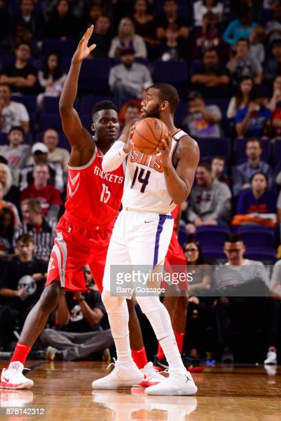 Greg Monroe of the Phoenix Suns passes the ball against Clint Cappella of the Houston Rockets on November 16 2017 at Talking Stick Resort Arena in...