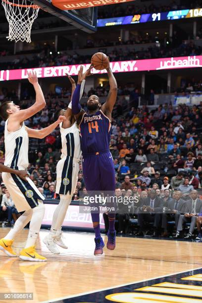 Greg Monroe of the Phoenix Suns shoots the ball against the Denver Nuggets at Pepsi Center on January 3 2018 in Denver Colorado NOTE TO USER User...