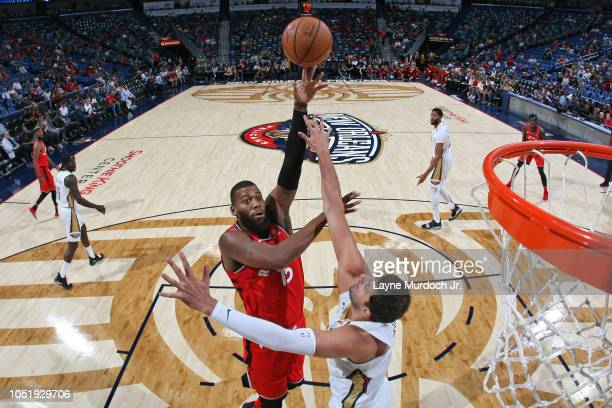Greg Monroe of the Toronto Raptors shoots the ball against the New Orleans Pelicans during a preseason game on October 11 2018 at Smoothie King...