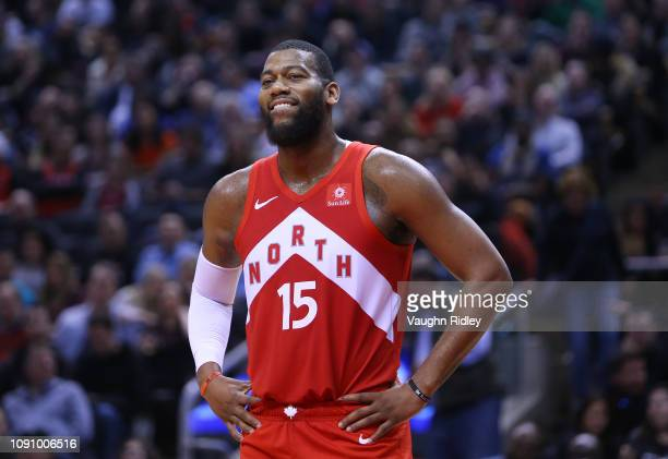 Greg Monroe of the Toronto Raptors smiles during the first half of an NBA game against the Indiana Pacers at Scotiabank Arena on January 6 2019 in...