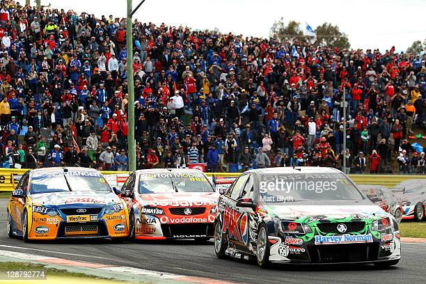 Greg Murphy leads the field in the Pepsi Max Crew Holden during the Bathurst 1000 which is round 10 of the V8 Supercars Championship Series at Mount...