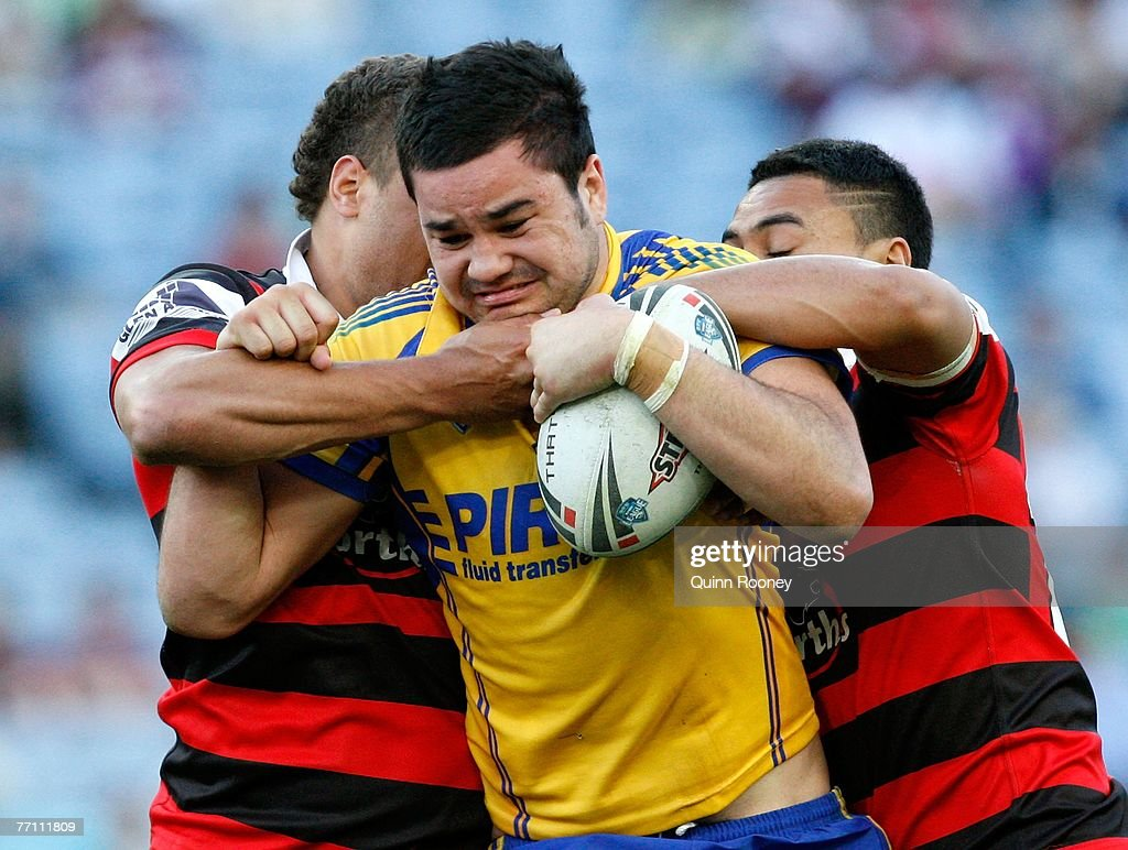 Greg Nichols of the Eels is tackled by the Bears defence during the 2007 Premier League Grand Final between the Parramatta Eels and the North Sydney Bears at Telstra Stadium September 30, 2007 in Sydney, Australia.