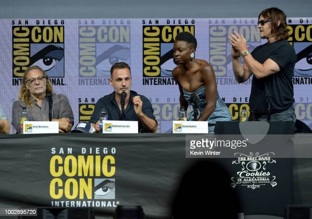 "Greg Nicotero, Andrew Lincoln, Danai Gurira, and Norman Reedus speak onstage at AMC's ""The Walking Dead"" panel during Comic-Con International 2018 at..."