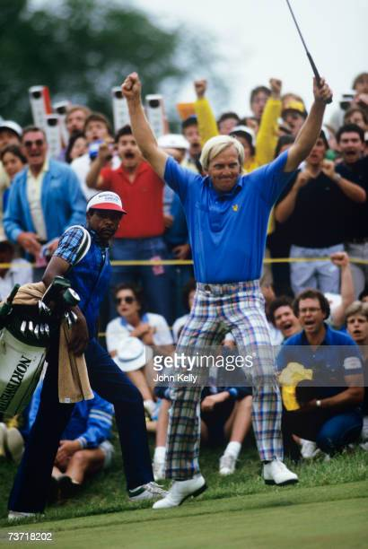 Greg Norman celebrates his birdie putt that forces a playoff with Fuzzy Zoeller during the 1984 US Open at the Winged Foot Golf Club.