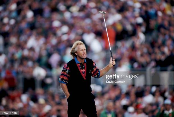 Greg Norman of Australia acknowledges the crowds as he walks to the green on the final hole during the final round of the 122nd Open Championship at...