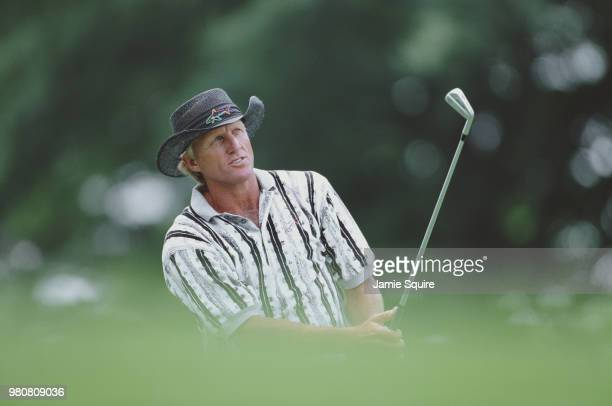 Greg Norman of Australia follows his shot during practice for the 97th United States Open Championship golf tournament on 11 June 1997 at the Blue...